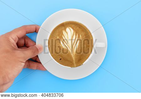 Top View Hand Man Holding  White Coffee Coasters With Cappuccino Coffee And Creamy Shape In White Cu