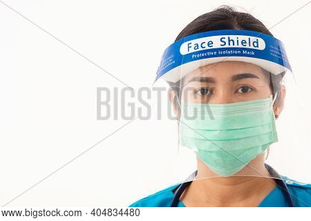 Closeup Woman Medical Staff Nurse Wearing A Face Mask Protective And Plastic Face Shield For Quarant