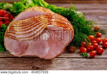 Spiral Sliced Hickory Smoked Ham With Fresh Herb And Tomatoes. Holiday Food.