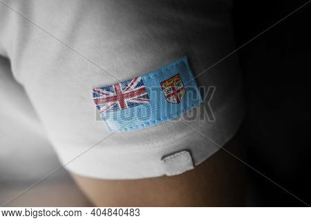 Patch Of The National Flag Of The Fiji On A White T-shirt