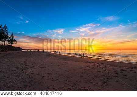 People Enjoying Their Time At Christies Beach During Beautiful Sunset On A Warm Summer Evening