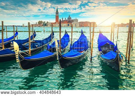Great Touristic Place In Venice With Anchored Gondolas On The Grand Canal, Italy, Europe