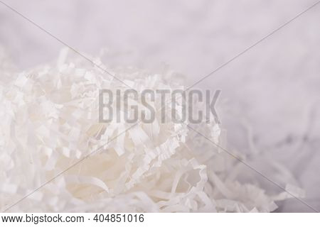 Background Of White Shredded Paper. Strips Of Sliced Corrugated Paper For Packing