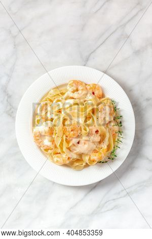 Pappardelle Pasta With Shrimps And Cream Sauce, Shot From The Top With A Place For Text
