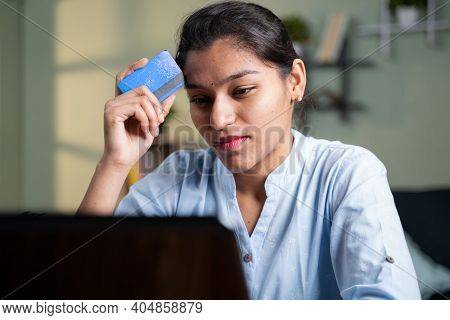 Worried Young Business Woman While Doing Online Payment Thorough Credit Card On Laptop - Concept Uns