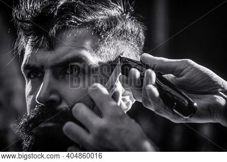 Hands Of Barber With Hair Clipper. Barber Works With Hair Clipper. Hipster Client Getting Haircut. H