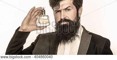 Masculine Perfume, Bearded Man In A Suit. Male Holding Up Bottle Of Perfume. Closeup Portrait. Perfu