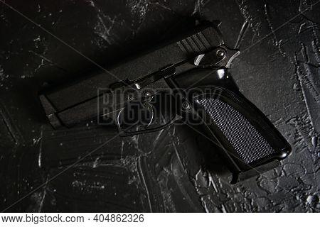 Gun On Black Texture Table. Ammunition Of Law Enforcement Agencies. Pistol For Cop. Firearm For Defe