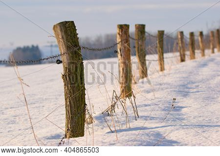 Snowy Winter Landscape With An Old Woden Fence