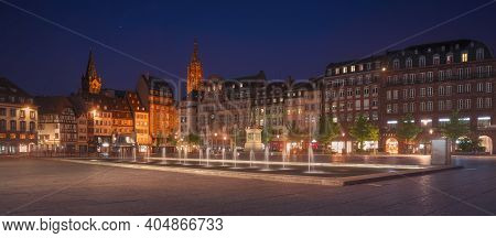 Strasbourg, Ebening In Central Place Kleber Square. Fountain In The Middle And Cathedral On Backgrou