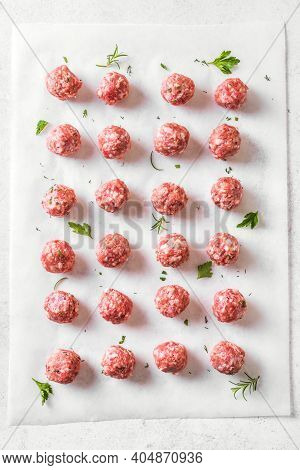 Raw Meatballs On White Background, Top View. Beef Meatballs Ready For Cook.