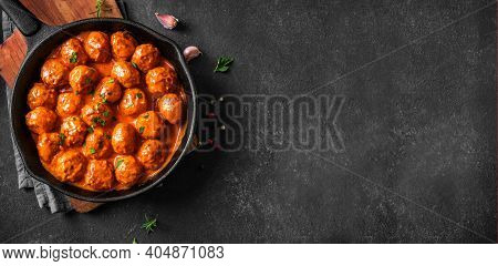 Homemade Meatballs In Tomato Sauce, Top View, Copy Space. Beef Meatballs In Cast Iron Pan On Black B