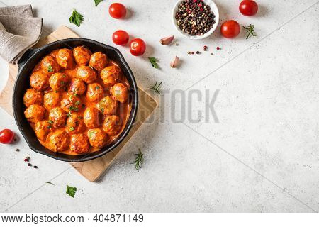 Homemade Meatballs In Tomato Sauce, Top View, Copy Space. Beef Meatballs In Cast Iron Pan On White B