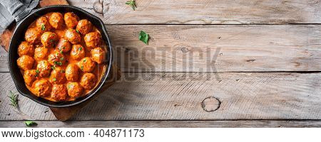 Homemade Meatballs In Tomato Sauce, Top View, Copy Space. Beef Meatballs In Cast Iron Pan On Wooden