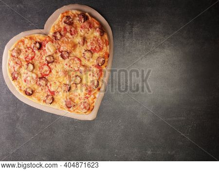 Delicious Pizza In The Form Of A Heart For Valentine's Day On A Dark Table Background