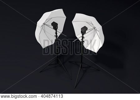 Photography Studio Lighting Stand With Flash And Umbrella Isolated On Black