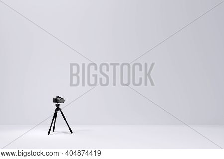 Photo And Video Tripod With Nonexistent Dslr Camera On The White Backgound
