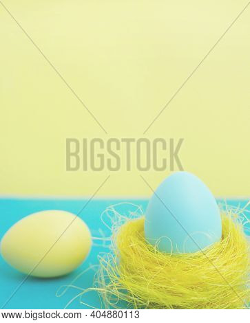 Happy Easter Greeting Card. Easter Egg On Yellow Beckground With Copy Space.
