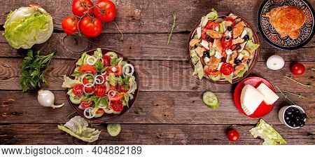 Two Salad.. Vegetable And Meat Salad Of Mozzarella, Cheese, Olives, Chicken, Cucumber, Tomatoes And