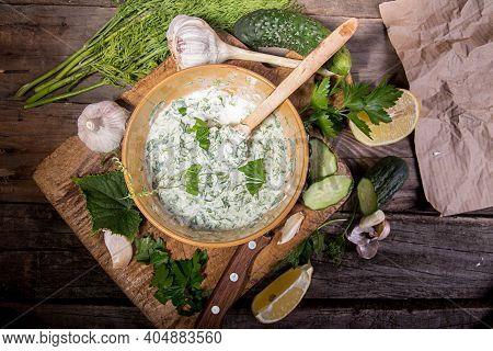 Dip Sauce Appetizer Tzatziki Of Cucumber, Yogurt, Garlic, Lemon And Dill. Creece Cuisine. Old Wooden