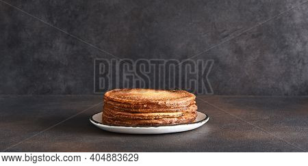 Stack Of Pancakes On The Plate On A Dark Background. Thin Pancakes. Good Morning.