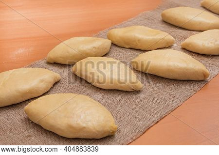 Russian Small Pies With Filling Prepared For Baking In The Oven. Homemade Baking.