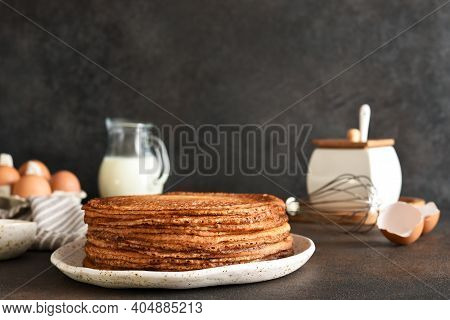 Stack Of Pancakes On The Plate For Breakfast. Pancake Ingredients: Milk, Eggs, Flour. Thin Pancakes.