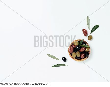 Olives Tree Leaves And Fruits On White Background. Small Bowl With Green, Black And Red Kalamata Oli