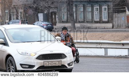 Astrakhan, Russia. January 25, 2021. A Beggar On The Road In Russia. Begging In Russia
