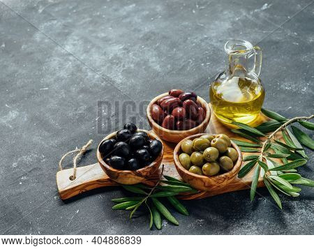 Set Of Green, Black And Red Or Pink Olives And Olive Oil On Gray Background. Different Types Of Oliv