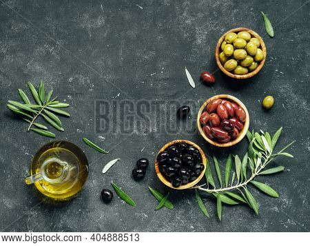 Set Of Green, Black And Red Or Pink Olives And Olive Oil On Dark Background. Different Types Of Oliv