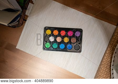 Kids Set Of Water Color Paints On Cozy Working Table Background. Top View.