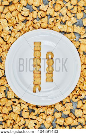 Scattered Alphabet Crackers And Good Morning Spelled With Crackers On A White Plate