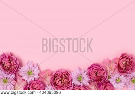 Frame Made Of Rose And Aster Flower Texture On A Pink Pastel Background With Copyspace. Springtime H