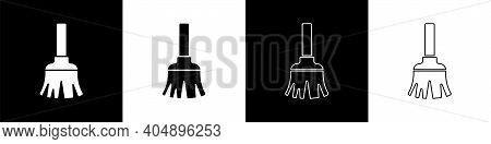 Set Feather Broom For Cleaning Icon Isolated On Black And White Background. Feather Duster. Vector