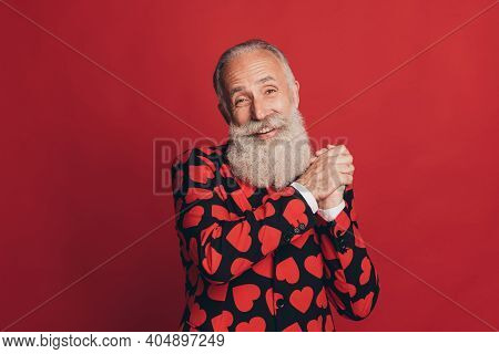Photo Of Cheerful Bearded Man Hold Palms Toothy Smile Look Camera Wear Heart Print Tuxedo Isolated R