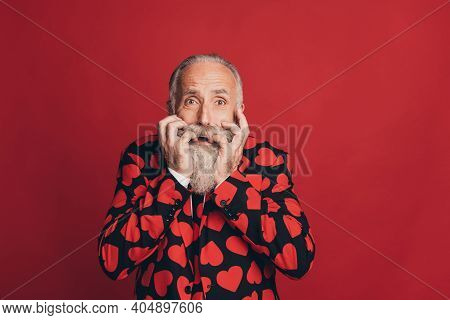 Photo Of Worried Scared Old Man Bite Nails Look Camera Horrified Face Wear Heart Print Suit Isolated
