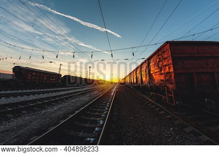 High-speed Train Moves By Rail, Delivery Of Goods By Freight Train. Train Carriages At The Station