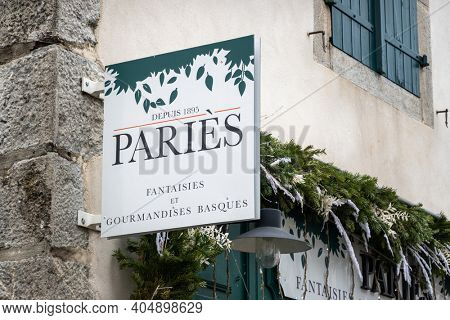 ESPELETTE, FRANCE - CIRCA JANUARY 2021: Paries sign outside shop. Paries is a chocolate, pastry, ice cream and confectionery maker from the French Basque Country.
