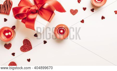 Valentines Day Minimal: Red Love Hearts, Romantic Gift Box, Candle On White Background. Sainte Valen