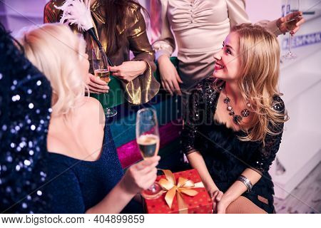Five Modern Well-dressed Caucasian Ladies Partying Together