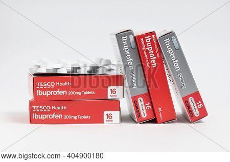 London / Uk - January 23rd 2021 - Ibuprofen Packets, Stacked Against A White Background
