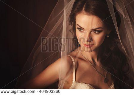 Bride Morning Preparation. Beautiful Bride In White Wedding Negligee And Veil. Sexy Bride. Bride Wit