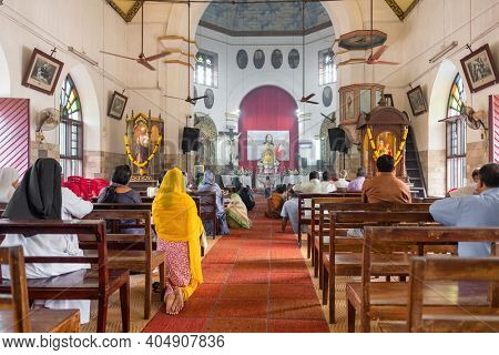 Cochin, India - November 29, 2019: Unidentified indian people praying during holy mass in christian church in Kerala state, India