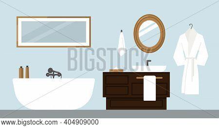 Modern Bathroom. Deluxe Hotel Room, Spa Salon, Suite.  Bath, Sink, Bathrobe, Lights, Towels, Cosmeti