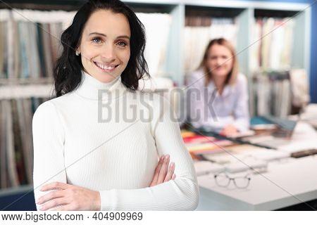 Portrait Of Smiling Female Consultant In Tissue Salon. Customer Service Rules Concept