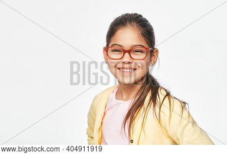 Smiling Mixed Race Child With Stylish Eyeglasses, Isolated On Light Grey Background. Vision Correcti