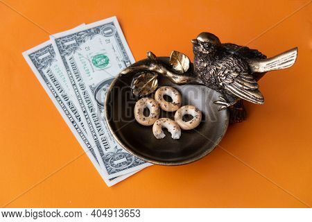 A Bronze Bird Pecks At The Steering Wheel And Brings Good Luck In Business, There Are Dollars Next T