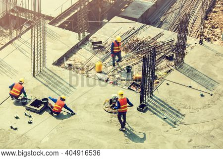 Construction Workers Undergoing Construction Smoothed The Cement Floor At The Construction Site. Lar