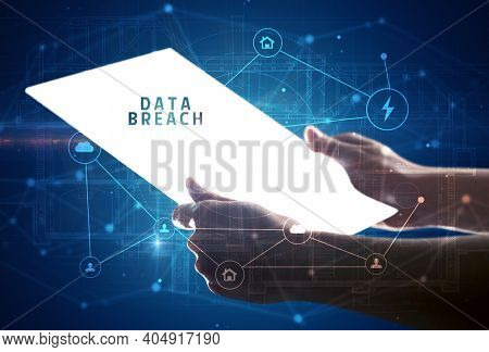 Holding futuristic tablet with DATA BREACH inscription, cyber security concept